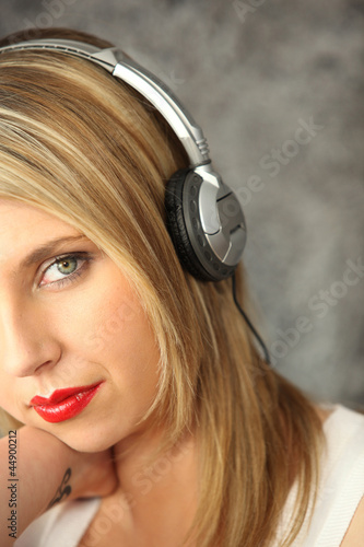 Blond women wearing headphones