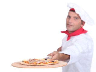 Cook serving pizza