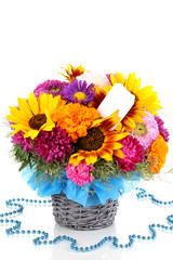 Beautiful bouquet of bright flowers with paper note isolated