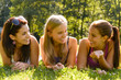 Teen women talking and relaxing in park