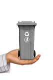 Hand offer gray trash can
