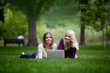 Young Women Using Laptop in Park