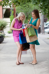 Women Looking Into Shopping Bags