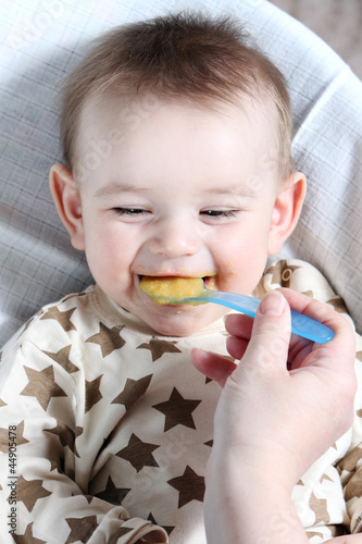 Baby boy eating vegetable mash