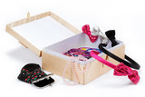 Women's accessories in the box on a white background.