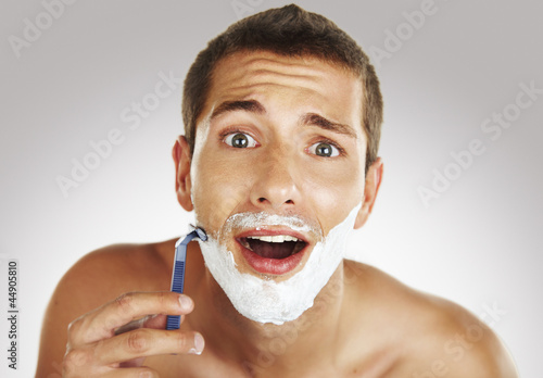 young man shaving in the bath