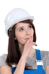 Portrait of a tradeswoman deliberating