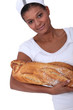 Bakery worker holding bread