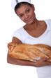 Bakery worker holding bread
