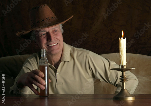 Beautiful elderly man sitting at a table