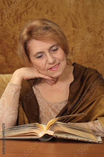 Beautiful Caucasian aged woman sitting