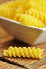 Uncooked fusilli, italian pasta, closeup