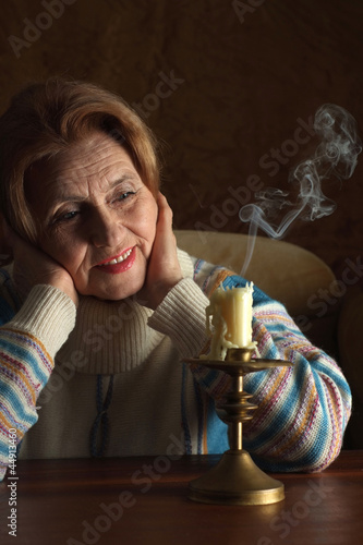 Beautiful aged woman sitting