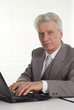 mature man sitting at the laptop