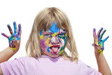 Angry kid with paints on hands. Isolated on white.