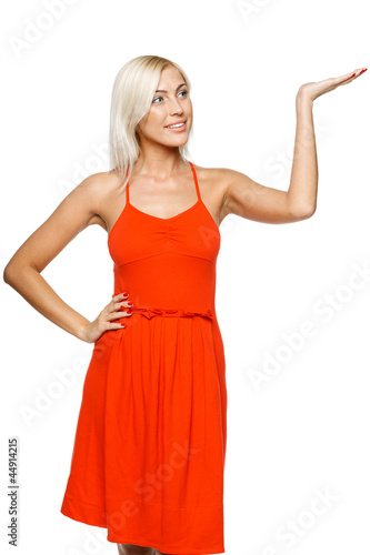 Smiling woman holding empty copy space on the open hand palm