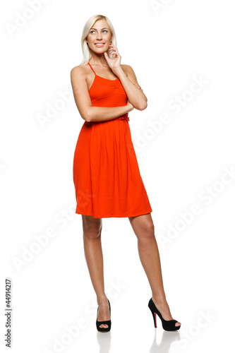 Full length of  woman standing looking to the side