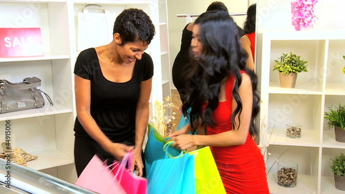 Female Friends Laughing over Shopping Bags