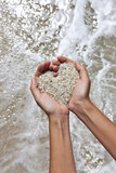 Mellow heart shaping female hands at beach poster
