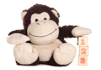Monkey soft toy learning to count
