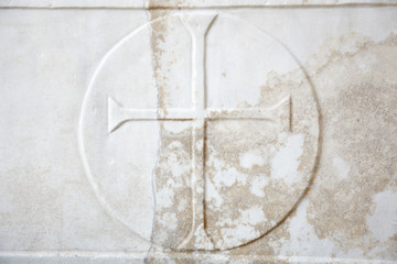 Cross carved in white marble background