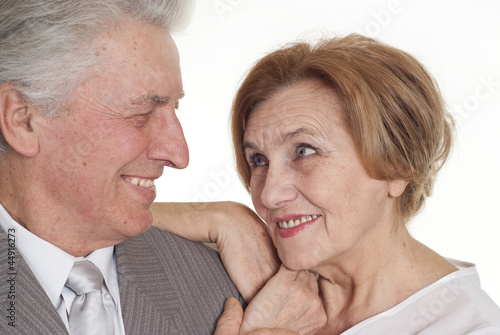 An senior with a woman standing