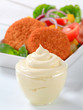 Fried cheese with vegetable salad and mayonnaise