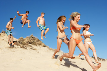 Group Of Teenage Friends Enjoying Beach Holiday Together