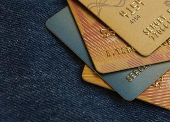 golden credit cards on jeans background