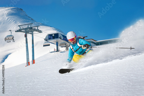Female skier having fun with fresh powder