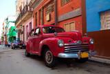 Fototapety Vintage red car on the street of old city, Havana, Cuba