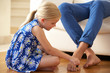 Daughter Painting Father's Toenails At Home