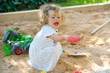 girl is playing in a sandbox
