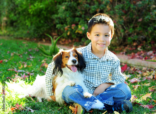A Young Boy and a Dog