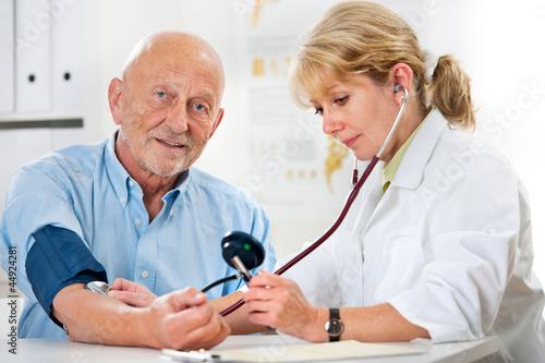Leinwandbild Motiv Blutdruckmessung