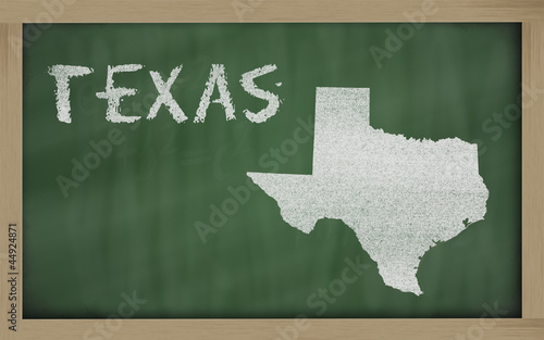 outline map of texas on blackboard