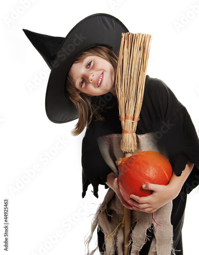 little girl with witch halloween mask