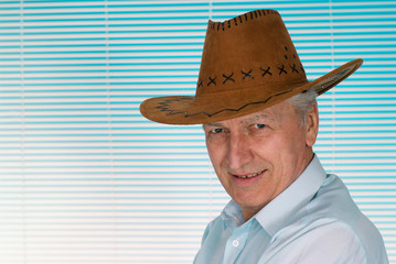 Elderly man in a cowboy hat
