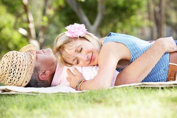 Senior Couple Relaxing In Summer Garden