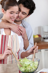Couple preparing a nice salad