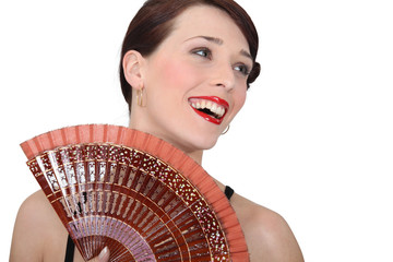 Woman with oriental hand fan