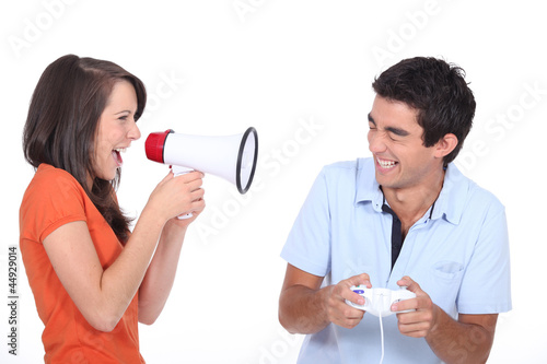 Girlfriend telling her boyfriend to stop playing video games