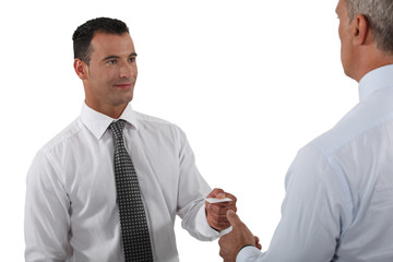 Man handing over his business card to a potential client