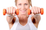 Woman using hand weights during fitness session