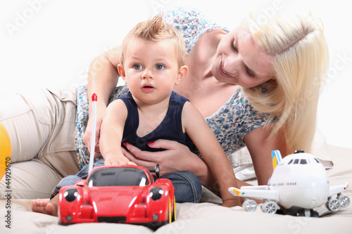 Little boy with radio-controlled car
