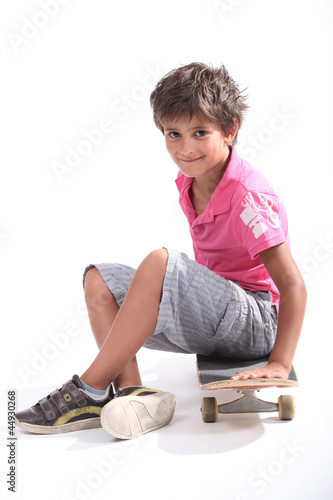 Child sitting on his skateboard