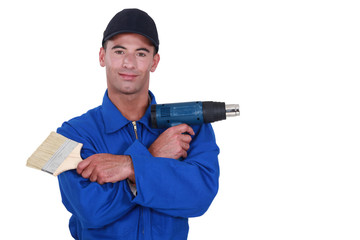 Man preparing to strip wallpaper