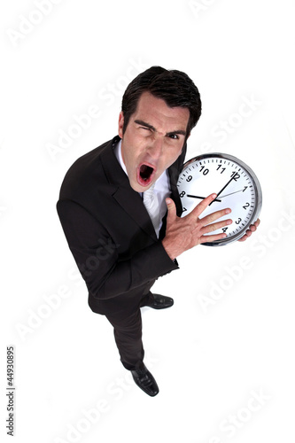 Man shouting with watch in hand