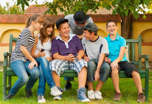 Teenage boys and girls having fun in the garden