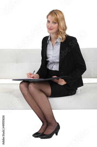 Blond woman taking survey